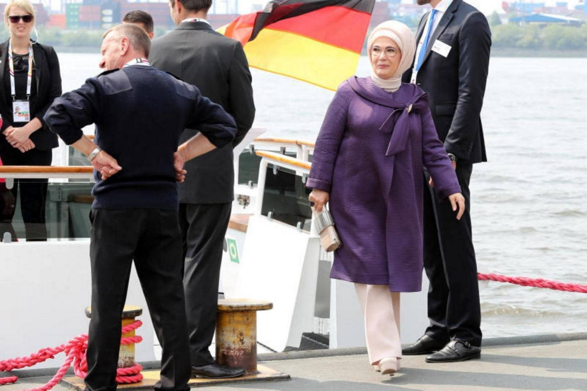Mrs Emine Erdogan, the wife of Turkish President Recep Tayyip Erdogan, leaves a ship after a boat tour on the first day of the G-20 summit in Hamburg, on July 7, 2017.