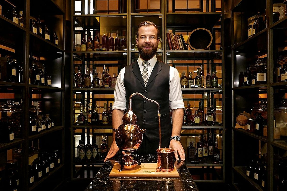 Bar manager Philip Bischoff in Manhattan's Whiskey Glasshouse. Miniature masterpieces by South Korean barista Lee Kang Bin.