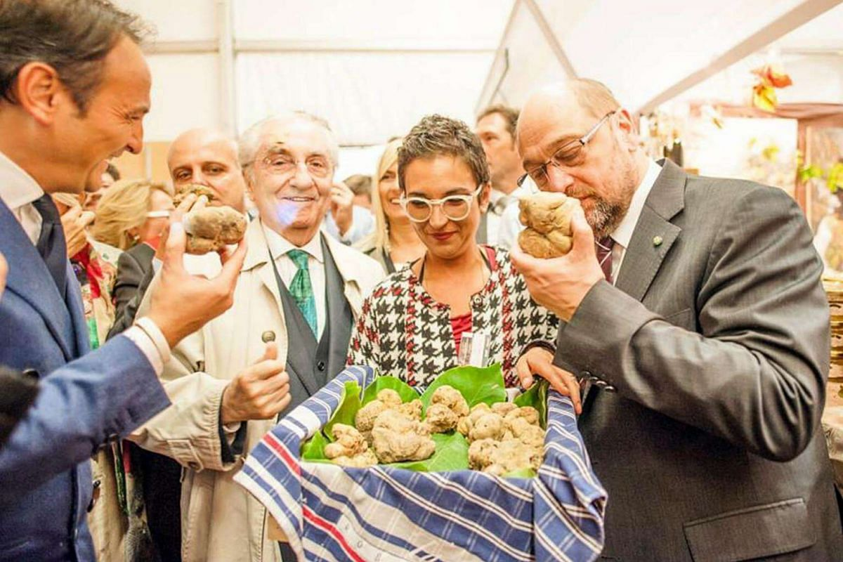 Smelling the unique fragrance of truffles at the annual Alba International White Truffle Festival in Alba, Italy.