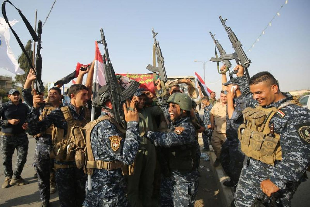 Iraqi federal police in a jubilant mood. Victory over the ISIS terrorists in Mosul is both a strategic and symbolic milestone for Iraqi fighters, backed by US-led coalition forces.