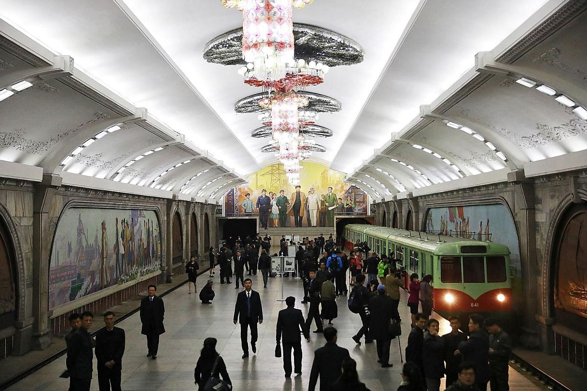 A rare peek into the infrastructure in North Korea as a subway train arrives in an underground station in the capital city.