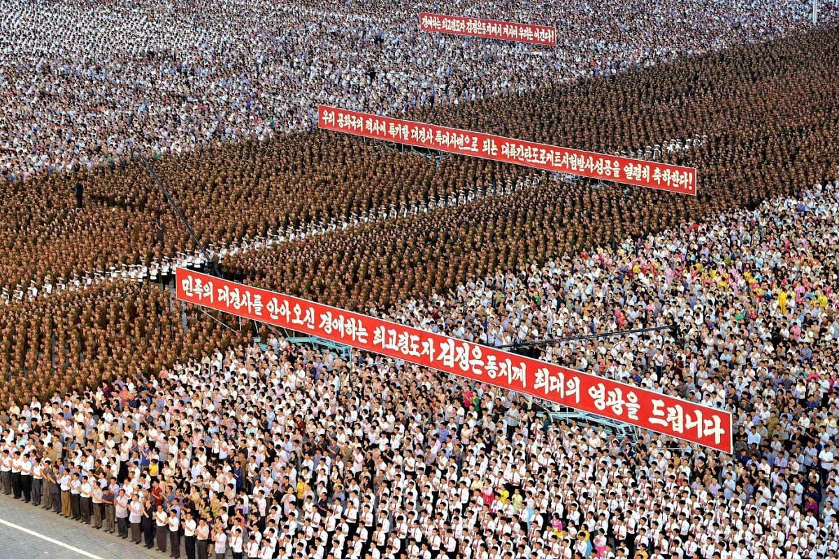 Army personnel and people gathering at Kim Il Sung Square, in Pyongyang, last Thursday to celebrate the success of the first test launch of an intercontinental ballistic missile that placed Alaska within its crosshairs.