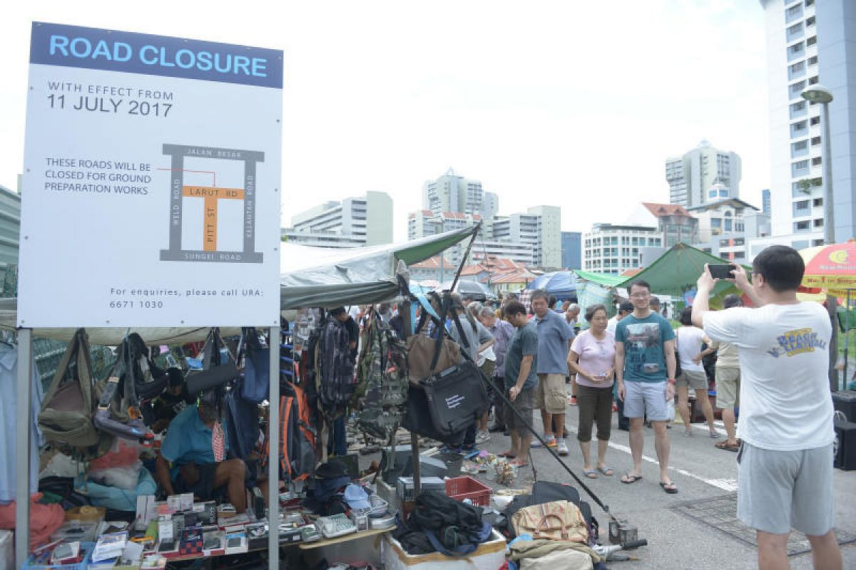 An official notice serves as a stark reminder of the market's demise. The last weekend of the thieves' market saw visitors scrambling to take their own final snapshots of what had become a Singapore institution.