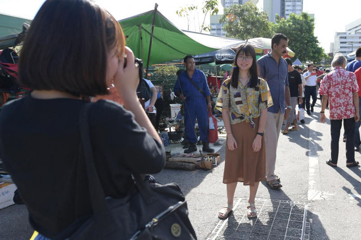 Nineteen-year-old Tay Ming Yi, who is waiting to enter university, was among the crowd at the Singei Road Thieves Market on its last day of operation. Ms Tan, who is into photography, was searching for cheap equipment for her hobby.