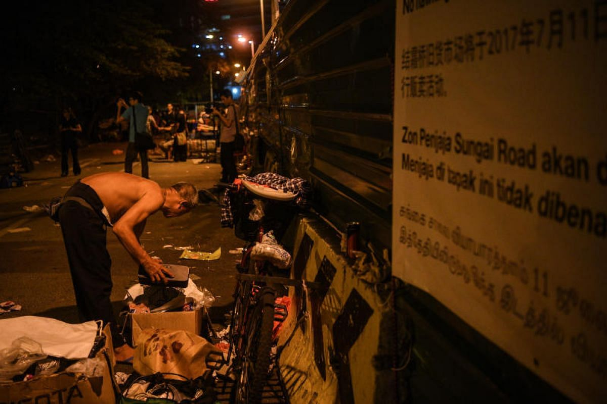 Dusk, and it's time to pack up for the last time. Hope, however, is on the horizon for the Sungei Road vendors as the market's association has secured another site - the sixth floor of Golden Mile Tower's carpark. According to association chairman K