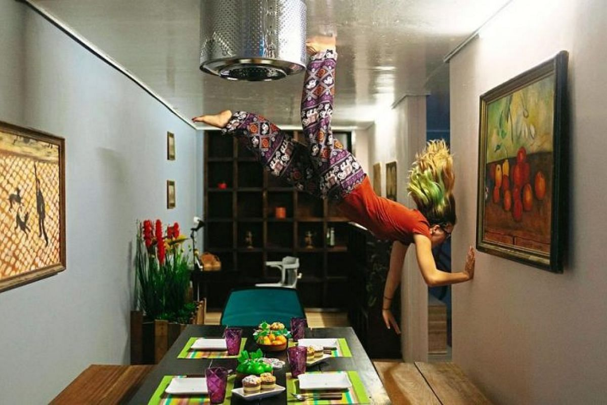 A visitor enjoying Upsidow, an upside-down house in Langkawi. It was opened in May 2017 by Alex Mark, who was inspired by a similar concept in his Austrian hometown.