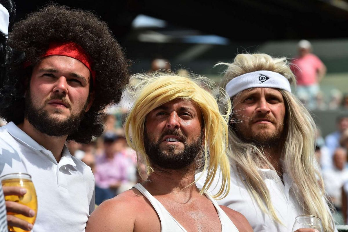 Tennis fans wearing wigs resembling legendary players watch Spain's Rafael Nadal play against Luxembourg's Gilles Muller during their men's singles fourth round match on the seventh day of the 2017 Wimbledon Championships at The All England Lawn Tenn