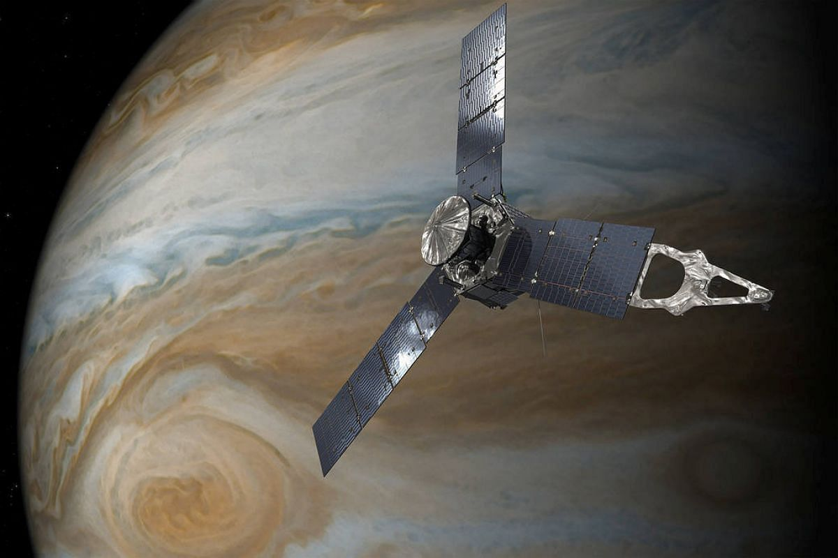 NASA's Juno spacecraft in orbit above JupiterÕs Great Red Spot is seen in this undated handout illustration obtained by Reuters July 11, 2017.