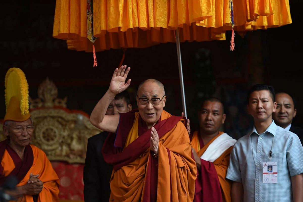 Tibetan spiritual leader the Dalai Lama waves as he arrives for his teachings during the 'Degon Yarchos Chenmo 2017' (Buddhist Summer Council) at the Diskit monastery in the Nubra Valley in India's Ladakh region near the Chinese border on July 12, 20