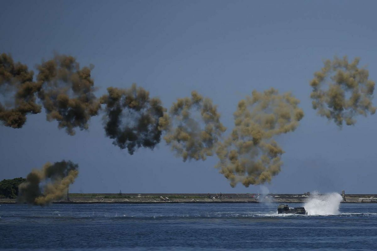 Taiwan Navy personnel lay down fire from an Assault Amphibious Vehicle (AAV 7) during a Naval exhibition drill in Kaohsiung City, Southern Taiwan, July 13, 2017. The Taiwanese navy performed the drill to showcase preparedness for any possible attacks