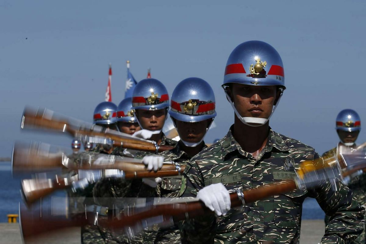 Taiwan honor guards perform during a Naval exhibition drill in Kaohsiung City, Southern Taiwan, July 13, 2017. The Taiwanese navy performed the drill to showcase preparedness for any possible attacks.