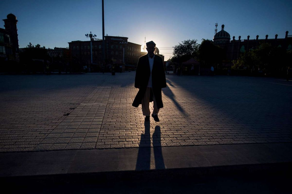 A Muslim man arriving at the Id Kah Mosque for the morning prayer on Eid al-Fitr in the old town of Kashgar in China's Xinjiang Uighur Autonomous Region.