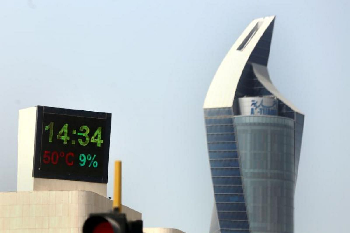 An electronic sign shows the temperature and humidity in Kuwait City on July 11, 2017, during a heatwave.