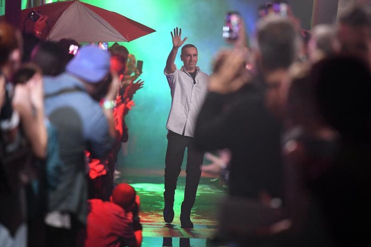 Designer Raf Simons acknowledging the cheers of the audience after his extravaganza of a show.
