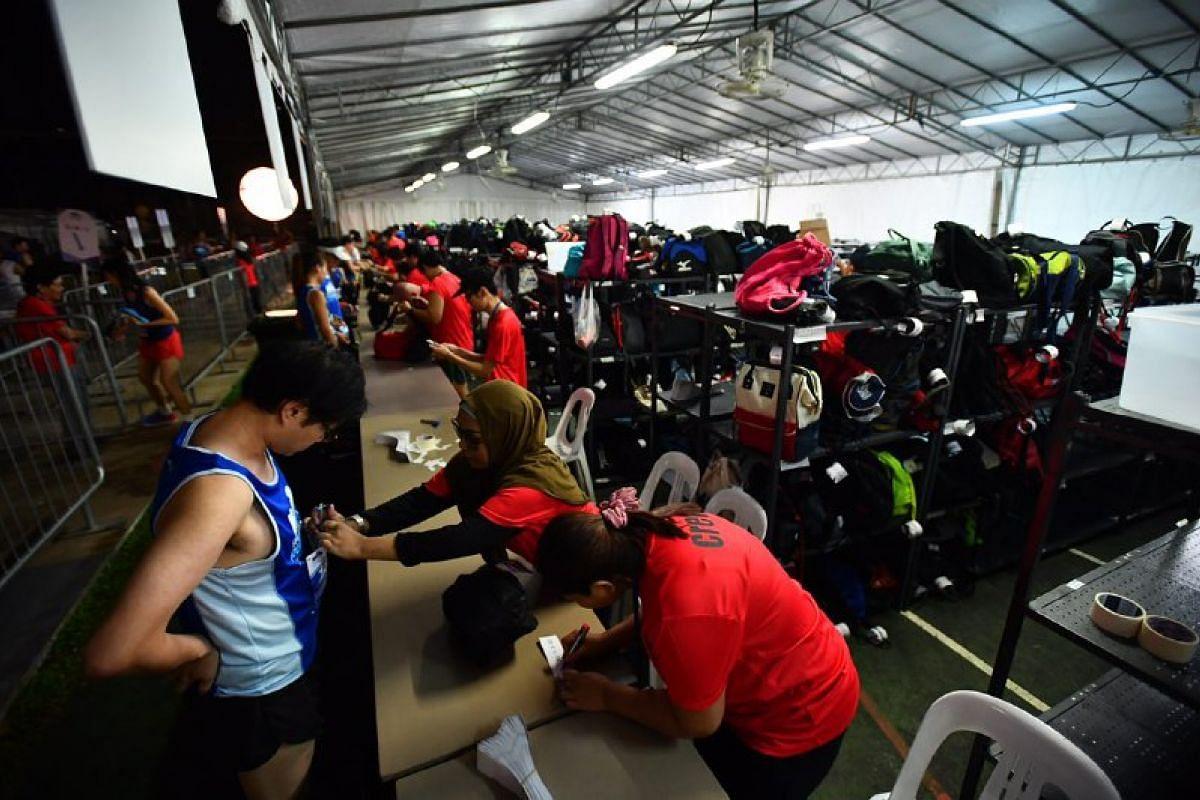 Runners depositing their bags.