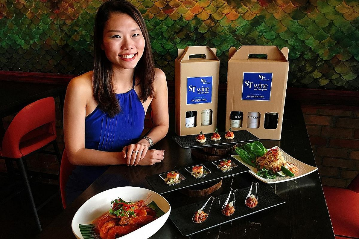 Ms Bonnie Wong, director of marketing and business development at Creative Eateries, with some dishes diners can enjoy when they order the catering menus.