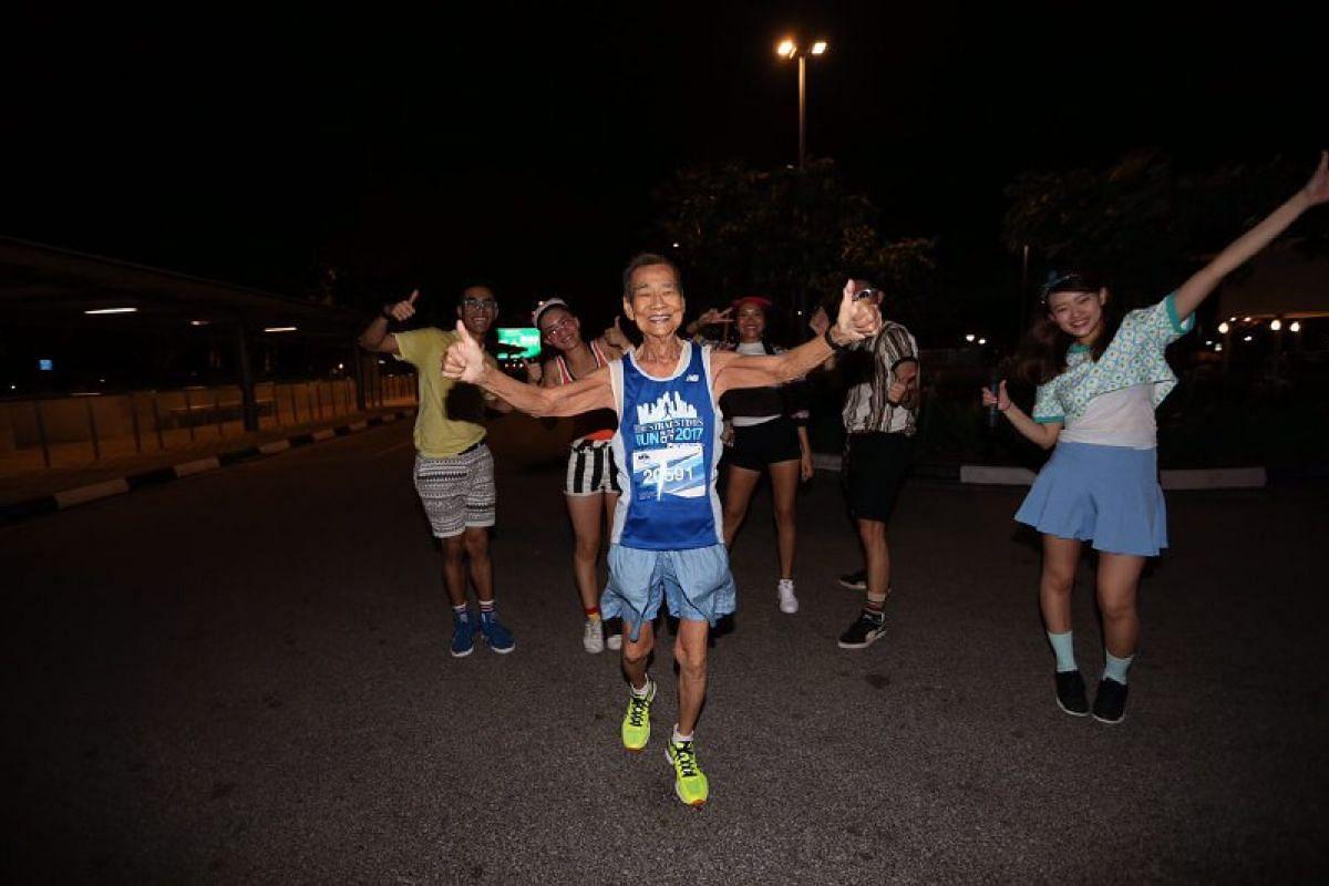 Singapore's oldest marathon runner, Chan Meng Hui, 87, seen at Zone 2 of the run.