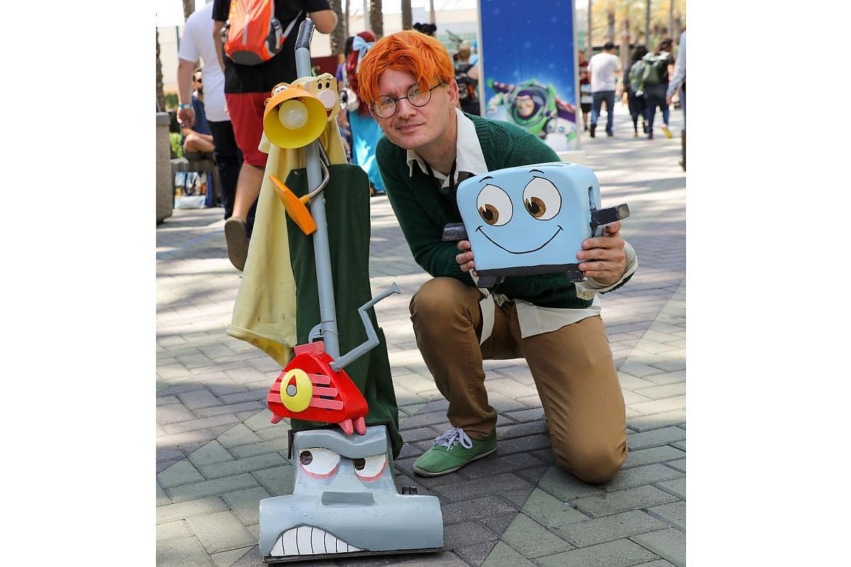 A Disney fan poses in his cosplay outfit during the D23 Expo in Anaheim, California on July 15, 2017.