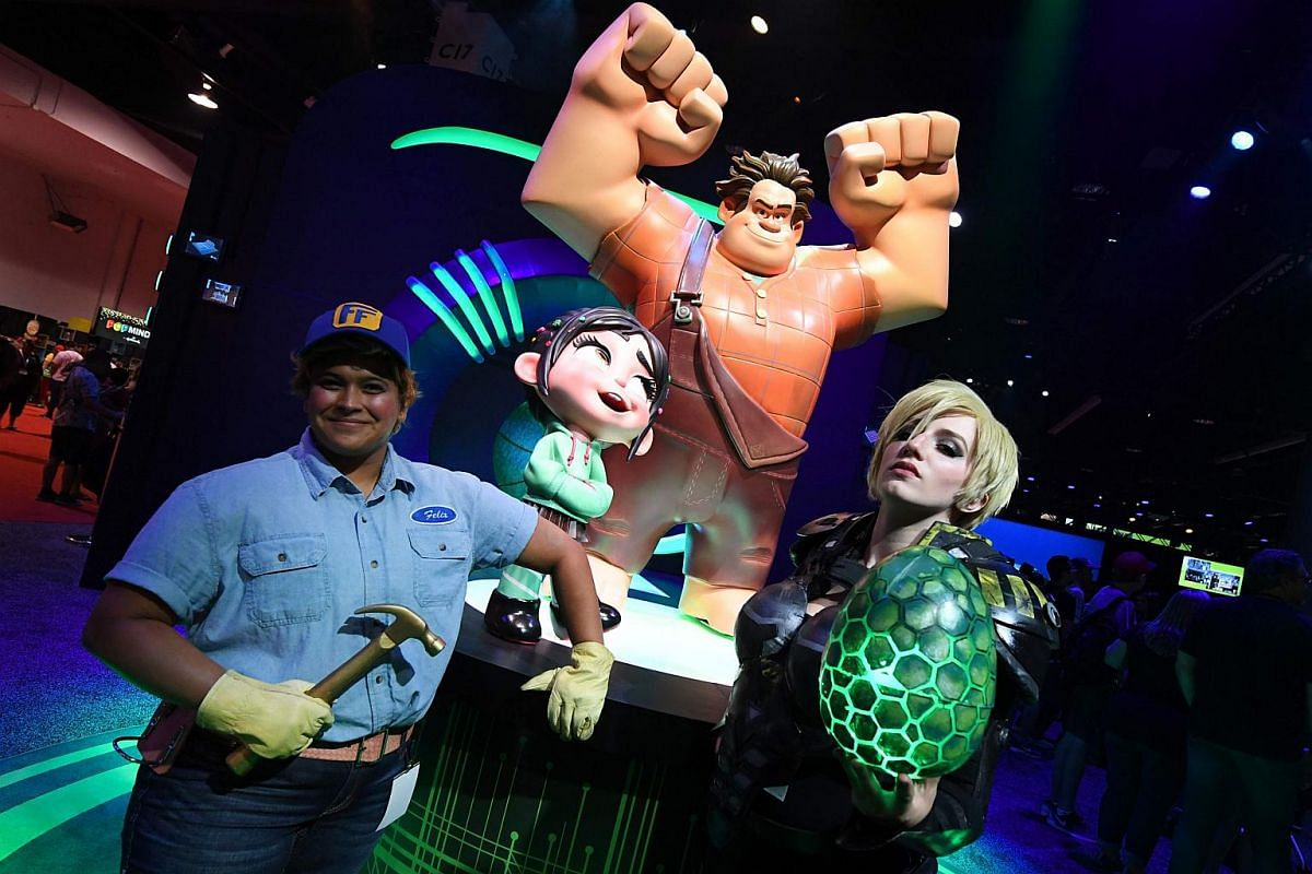 Fans and gamers pose during the D23 expo fan convention at the Convention Center in Anaheim, California, on July 15, 2017.