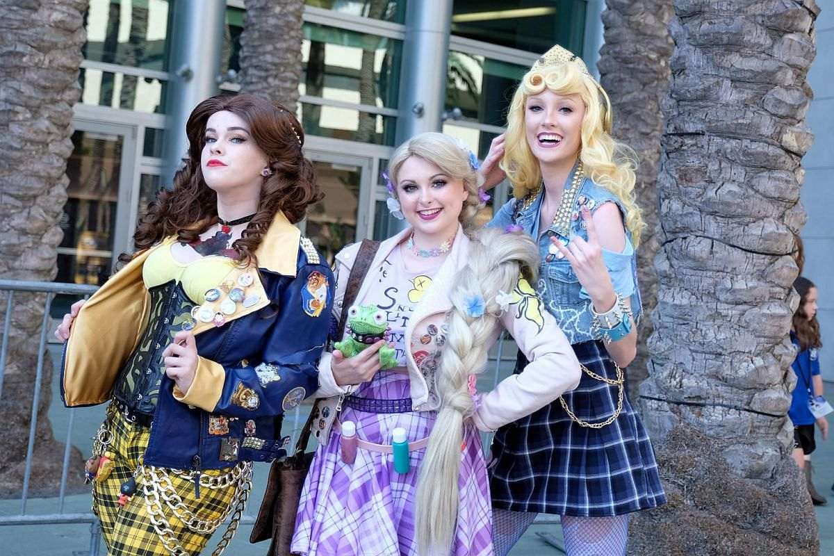 Fans and cosplayers attend the D23 expo fan convention at the convention center in Anaheim, California on July 14, 2017.