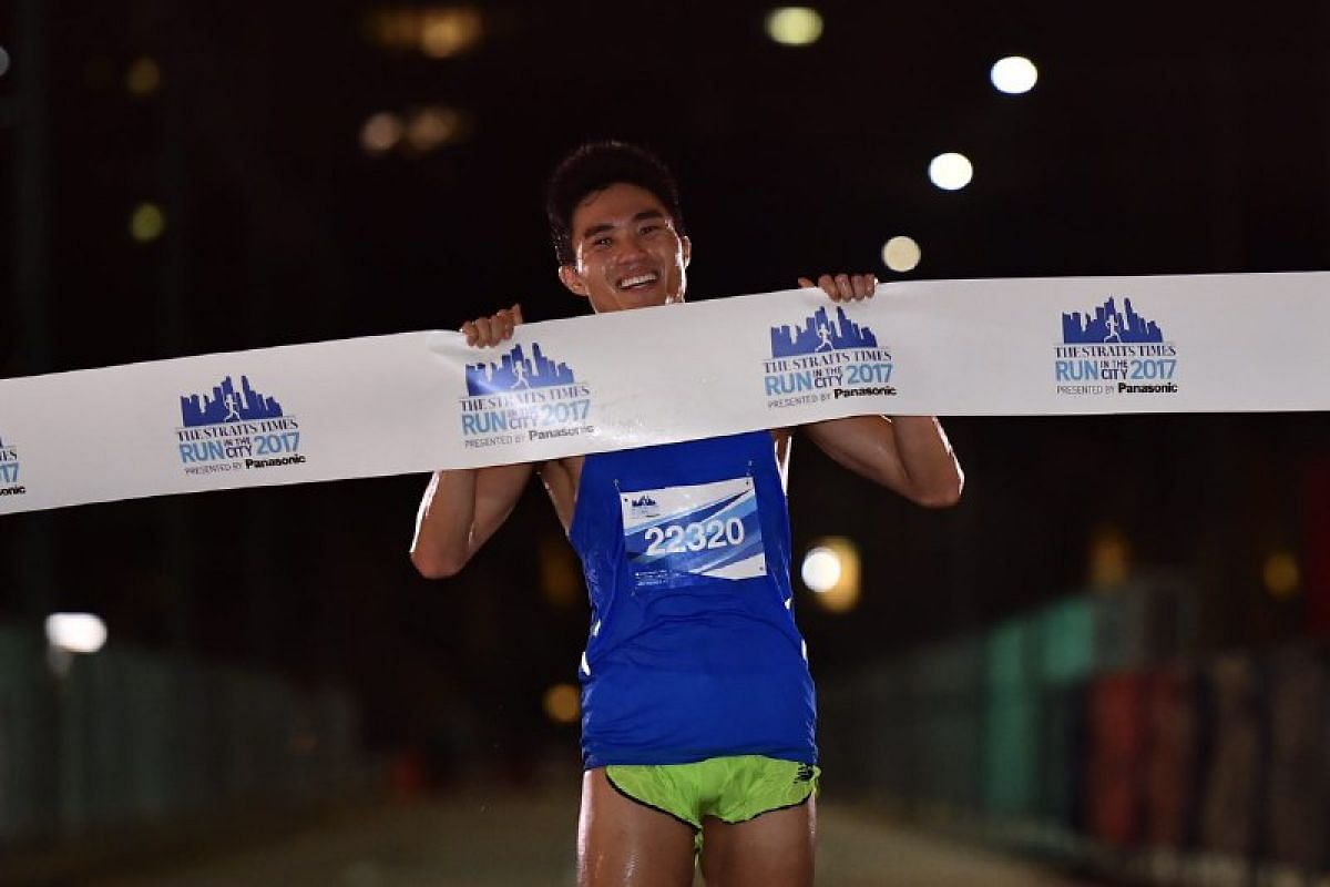 Mok Ying Ren crossing the finishing line after completing the 18.45km run.