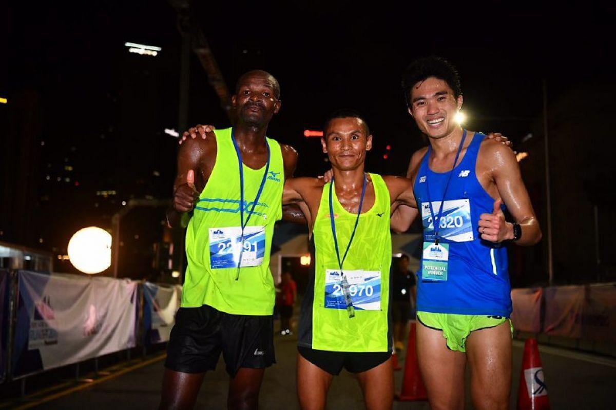 Winners of the 18.45km run: James Karanga (left) came in first place, followed by Nimesh Gurung (centre) and Mok Ying Ren.