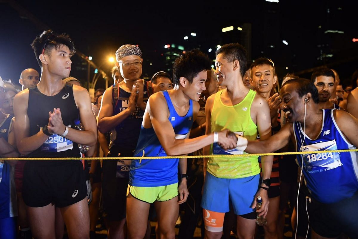 Runners shaking hands at the starting line.