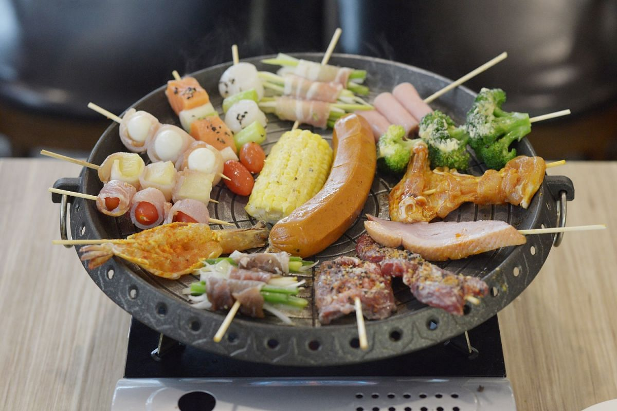 At Papa's Skewer Bar, diners grill skewers on a hot plate.