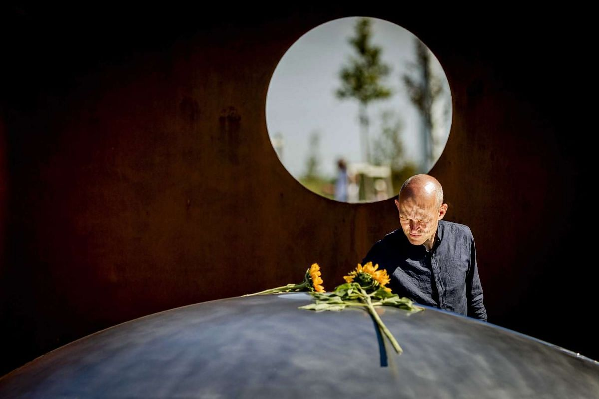 A relative attends an unveiling ceremony of the National Monument for the MH17 plane crash victims in Vijfhuizen, The Netherlands, July 17, 2017. Malaysia Airlines Flight MH17, an international passenger flight en route from Amsterdam to Kuala Lumpur