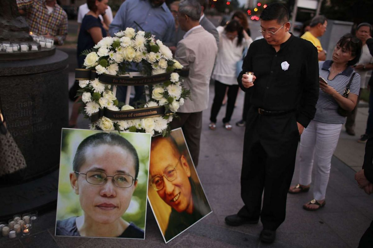 Yang Jianli holds a candle during a vigil in memory of Chinese Nobel Peace Prize laureate Liu Xiaobo on July 17, 2017 in Washington, DC. Liu, 61, died of multiple organ failure on July 13, 2017 as he was serving a 11-year prison term in China for the