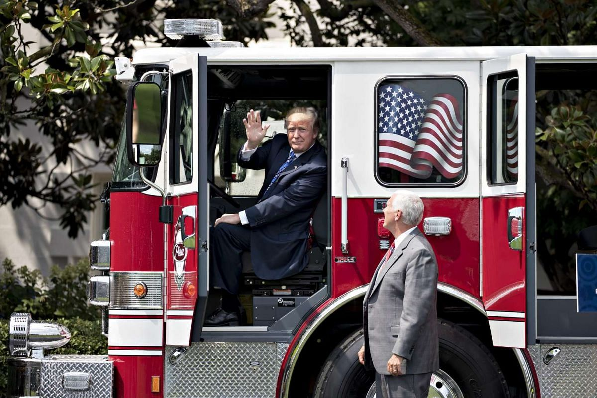 Mr Trump and Mr Pence checking out a US-made fire engine. PHOTO: BLOOMBERG