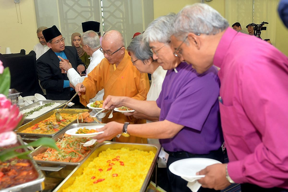 (From left) Mufti Fatris Bakaram and Parsi Zoroastrian Association president Rustom Ghadiali attending an interfaith Eid celebratory event on July 6, along with Buddhist Federation president Seck Kwang Phing, Sister Maria Lau of the Roman Catholic Ch