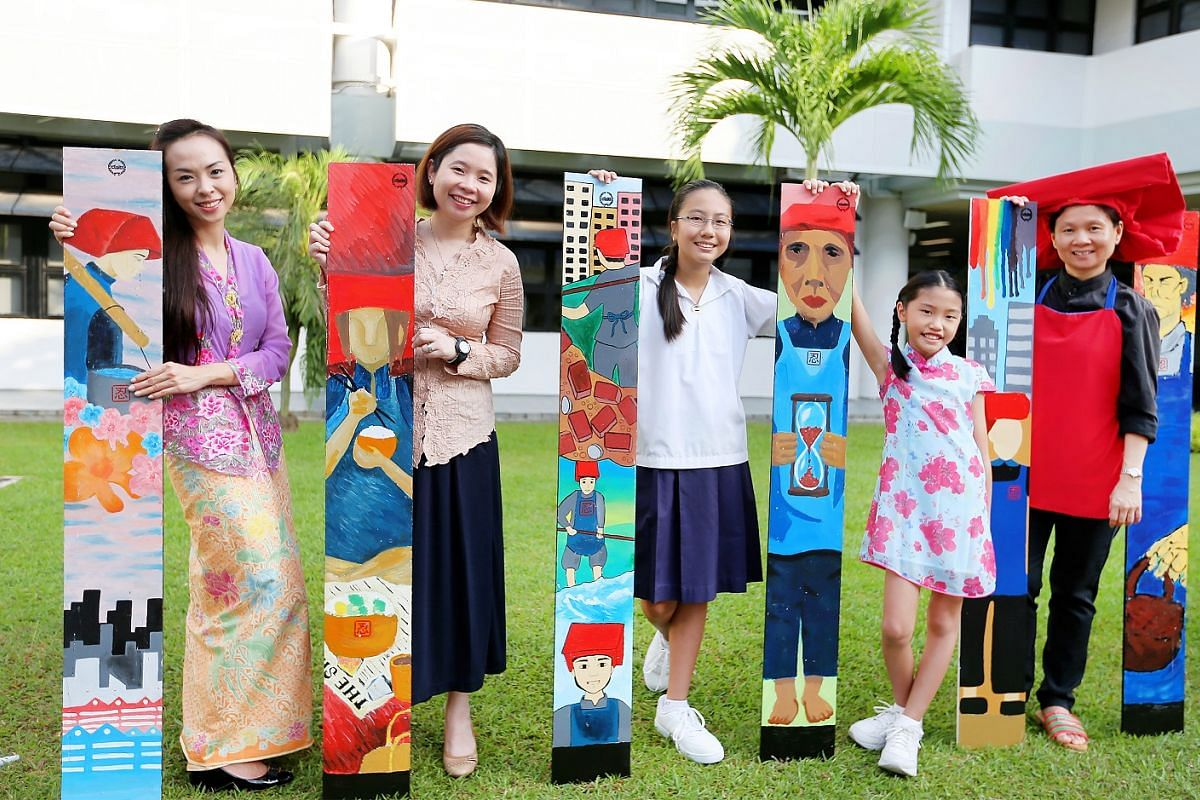 (From left) Art teacher Natasha Tay and history and social studies teacher Christina Loong, with students Anna Grace Wang and Alison Lim, and form teacher Chris Lim, marking Racial Harmony Day at Methodist Girls' School by honouring the pioneering