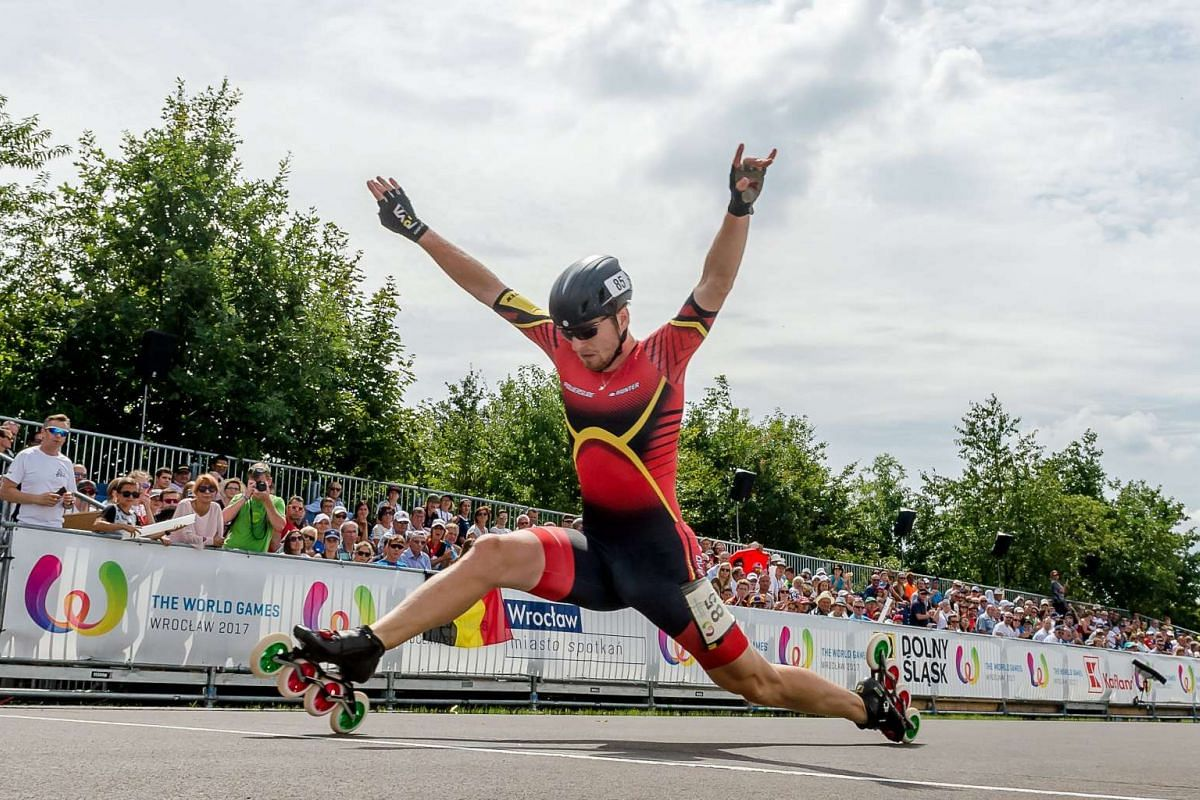 Simon Albrecht of Germany crosses the finish line during the men's time trial roller sports competition at the World Games of the non-Olympic sports in Wroclaw, Poland, July 24, 2017.