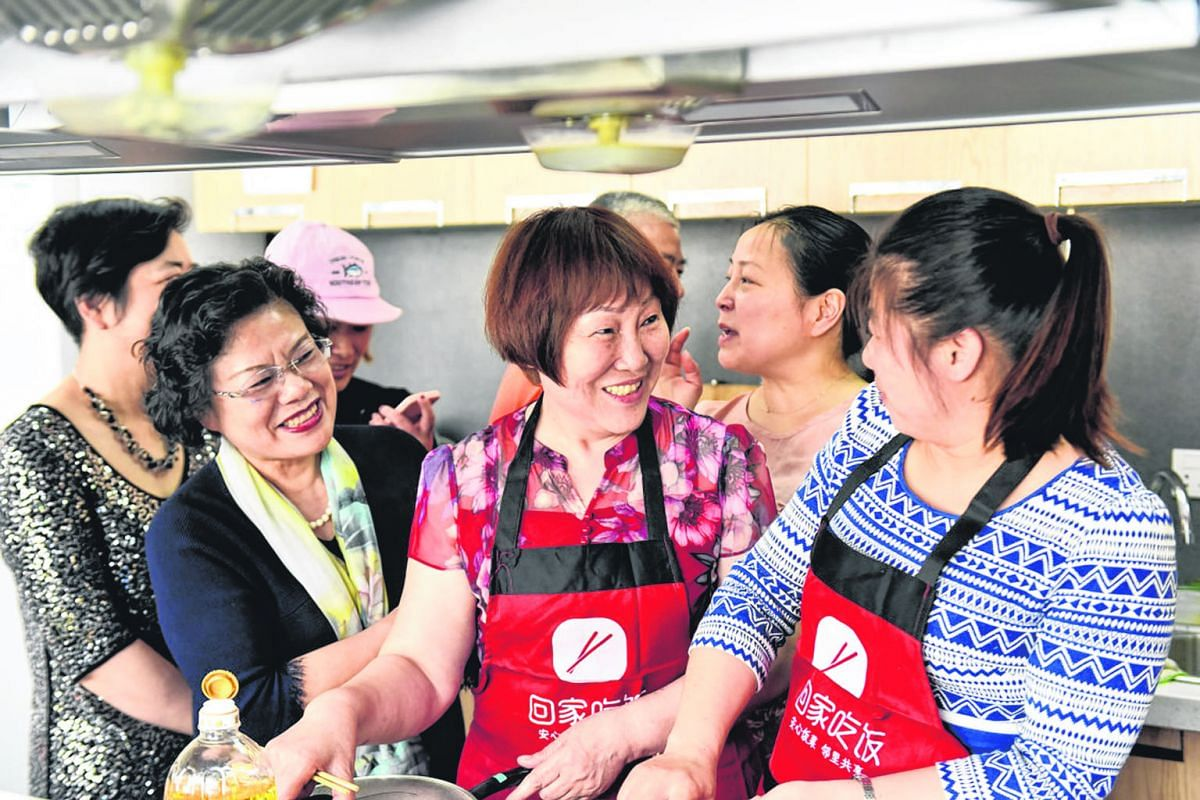 Chefs from Home Cook exchanging culinary tips at a gathering. Home Cook organises cooking competitions and other bonding activities for its chefs every week to encourage them to learn from one another. The company, which has two million registered us