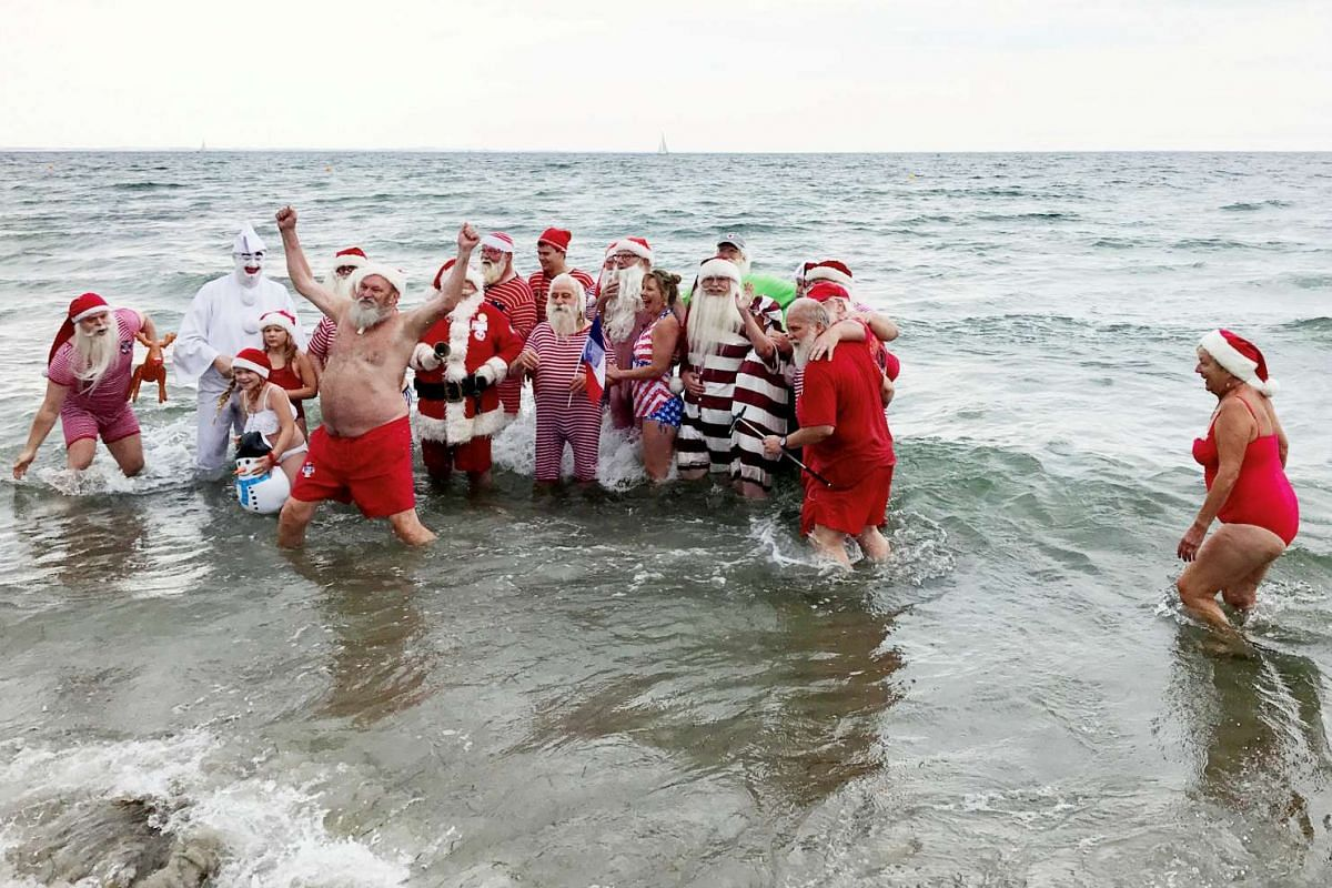 People dressed as Santa Claus taking take part in the World Santa Claus Congress, an annual event held every summer in Copenhagen, Denmark, on July 25, 2017.