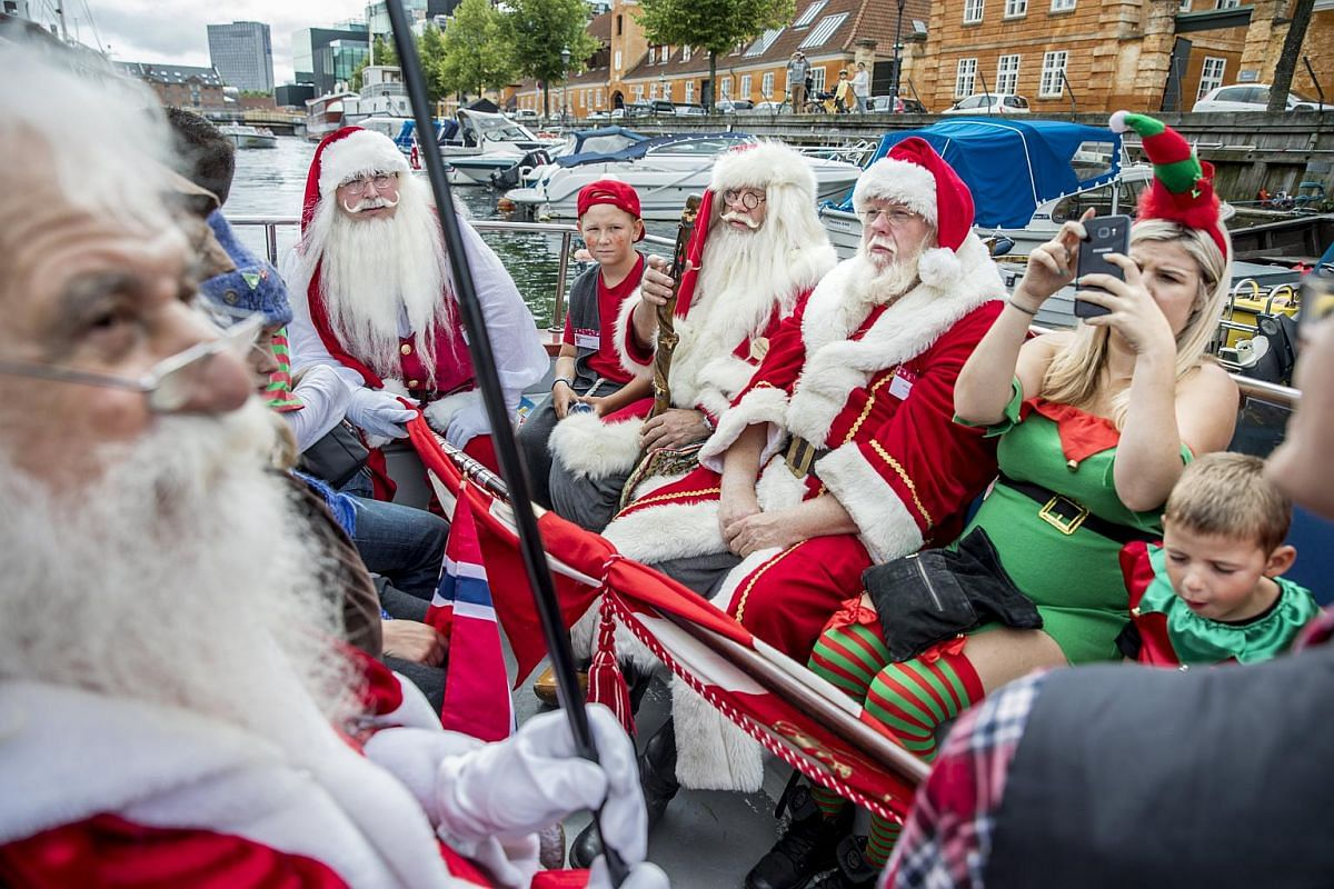 People dressed as Santas taking part in the Santa Claus canal tour as part of the annual Santa Claus World Congress in Copenhagen, Denmark, on July 24, 2017.
