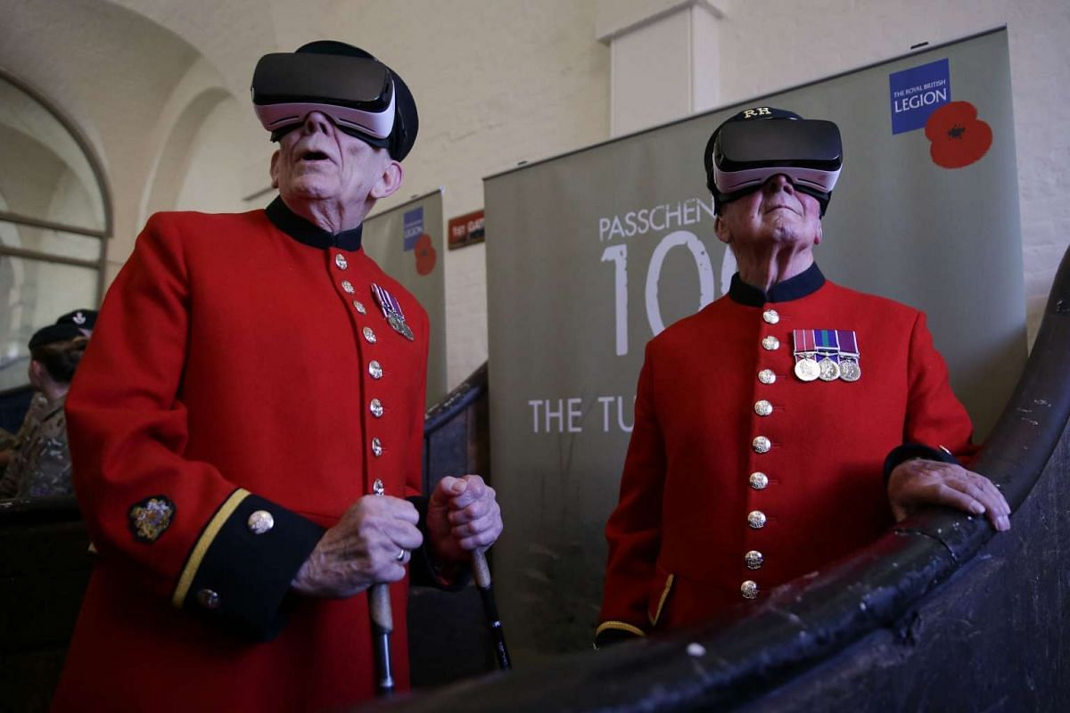 Chelsea pensioners John Kidman, 87, (L) and Bill 'Spud' Hunt, 83, wear Virtual Reality (VR) headsets at a photocall during the Royal British Legion launch of the Battle of Passchendaele virtual reality content at the Household Cavalry Museum in Westm