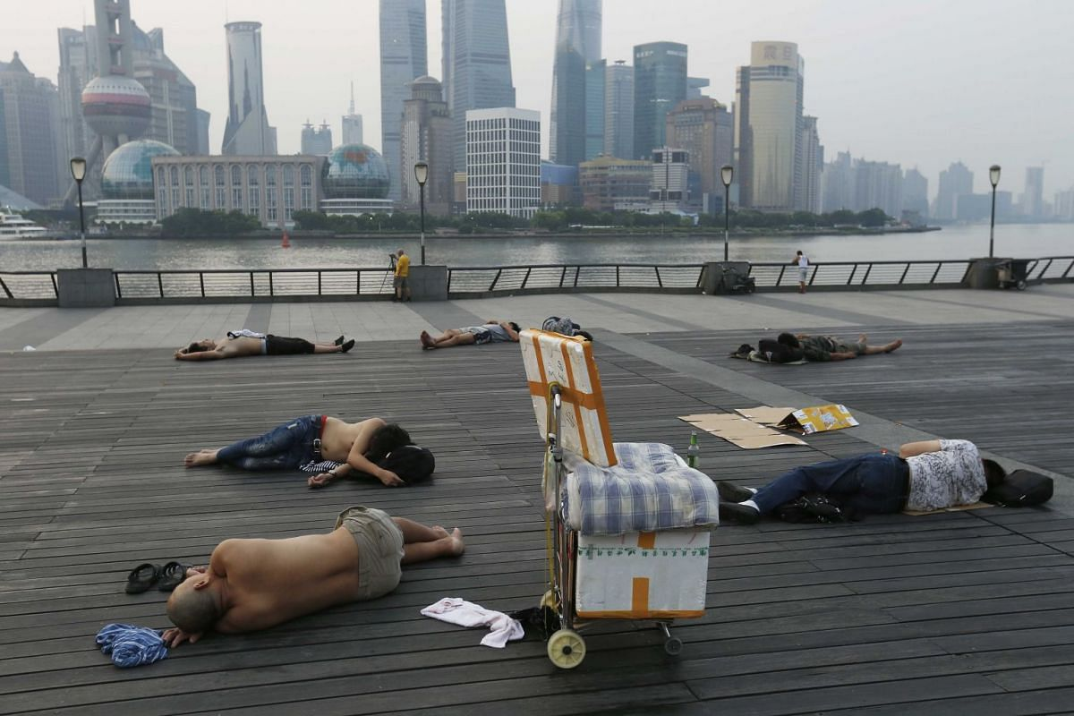 People sleep on the waterfront bund to keep cool in Shanghai. Parts of China including Shanghai have seen record temperatures in recent weeks, in what has been a torrid summer so far for much of the country, while large areas of south-central China h