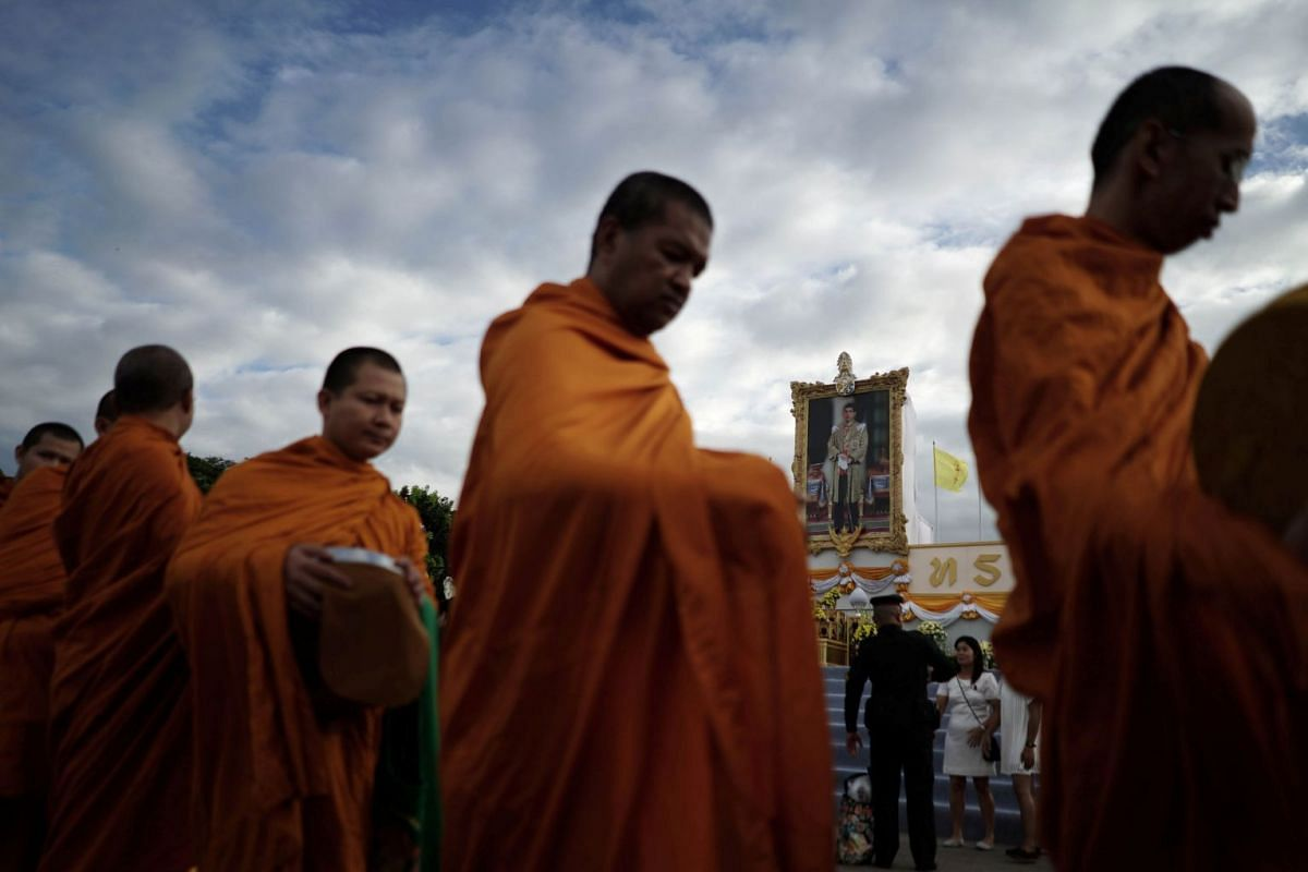 Buddhist monks line up while receiving alms as part of celebrations for the 65th birthday of Thai King Maha Vajiralongkorn in Bangkok, Thailand, on July 28, 2017.