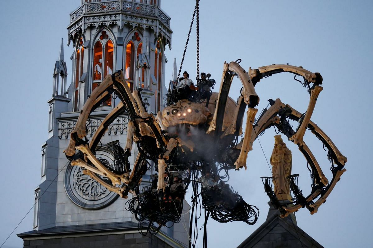 The giant mechanical spider Kumo, created by French production company La Machine, in front of the Notre-Dame Cathedral Basilica during a performance in Ottawa, Ontario, Canada, on July 27, 2017.