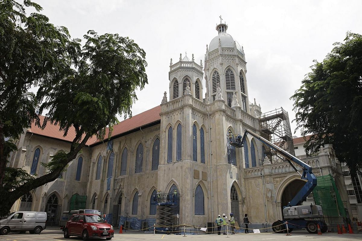 Removing the decades-old paint have revealed the true beauty of the foliage motifs on the church's column capitals (top) as well as the three marble statues of Catholic saints. In light of these new finds, St Joseph's Church, in the heart of the civi