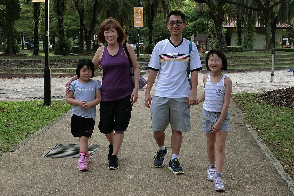 Yan Jie, six, with mum Wendy Wong, dad Tan Cheng Kang and sister Yan Yu, nine, taking a stroll in the park.