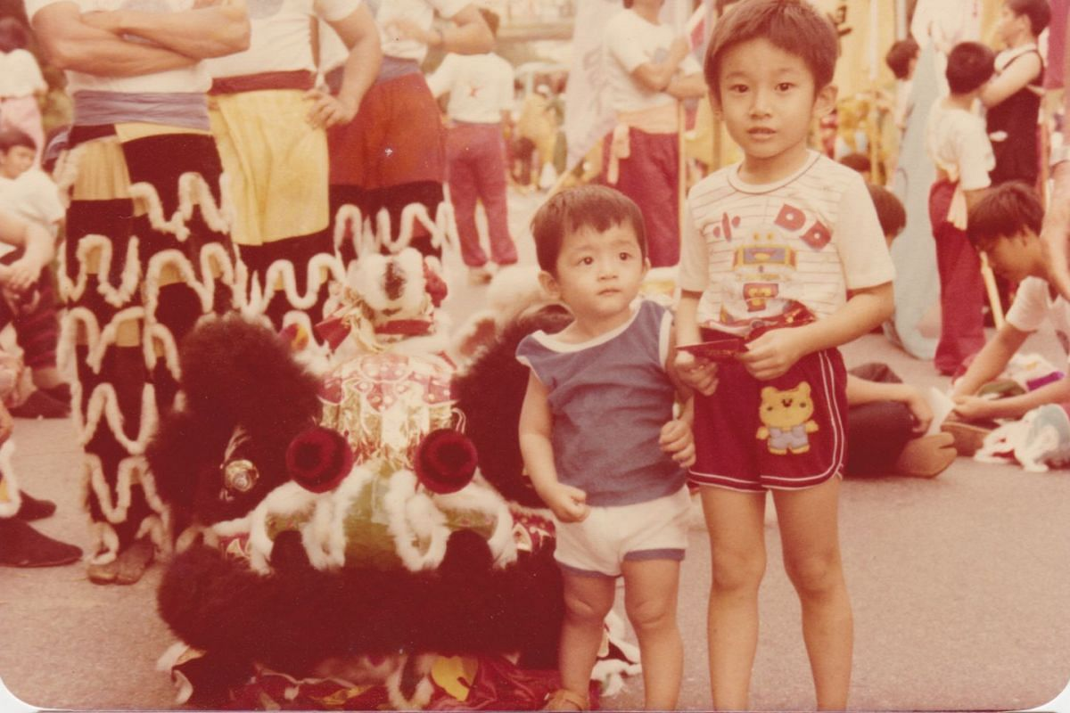 My Life So Far: Mr Kennie Ting as a five-year-old and with his brother Edwin, then aged two, at the Chingay parade in Jalan Bukit Merah.