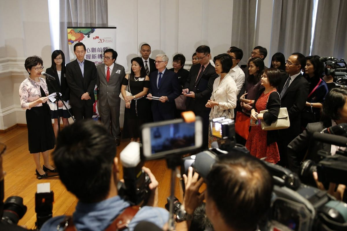 Mrs Lam surrounded by guests and members of the media as she delivers a speech at The Arts House on Aug 2.