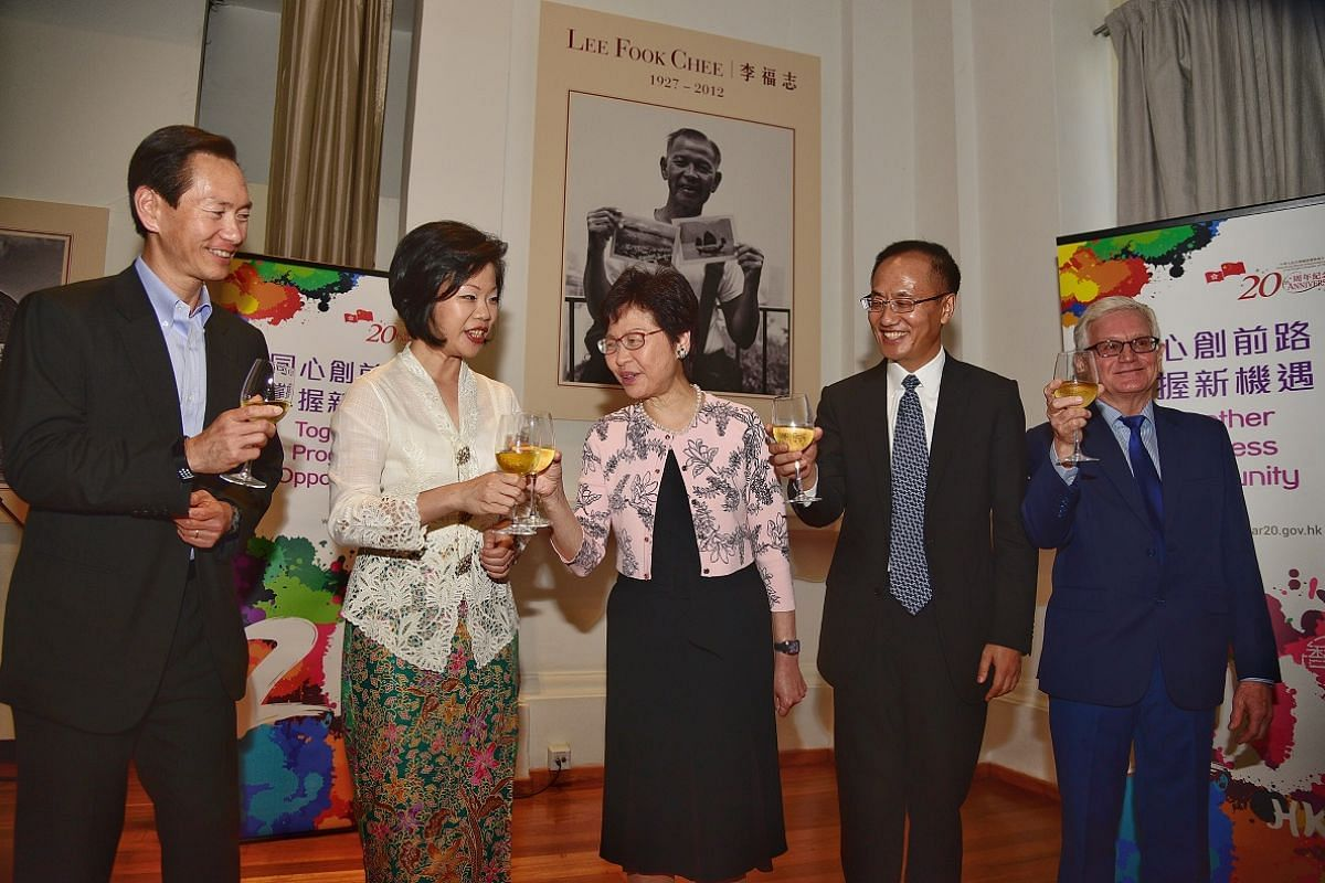 Mrs Carrie Lam (centre) toasting (from left) Mr Bernard Charnwut Chan, patron of the Photographic Heritage Foundation, Ms Sim Ann, Chinese ambassador to Singapore Chen Xiaodong and Mr Edward Stokes at The Arts House on Aug 2.