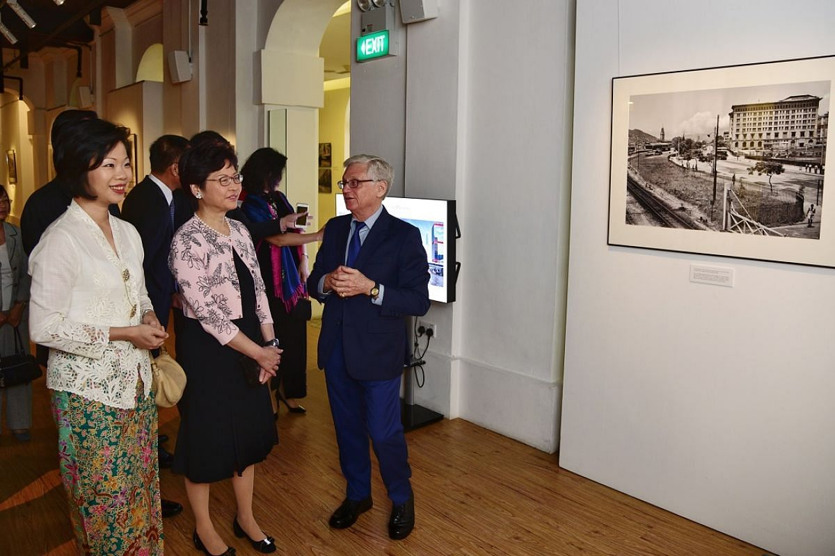 From left: Ms Sim Ann, Mrs Carrie Lam and Mr Edward Stokes, founder of the Photographic Heritage Foundation, at the opening reception of the photo exhibition, Son Of Singapore – Photographer Of Hong Kong, at The Arts House.