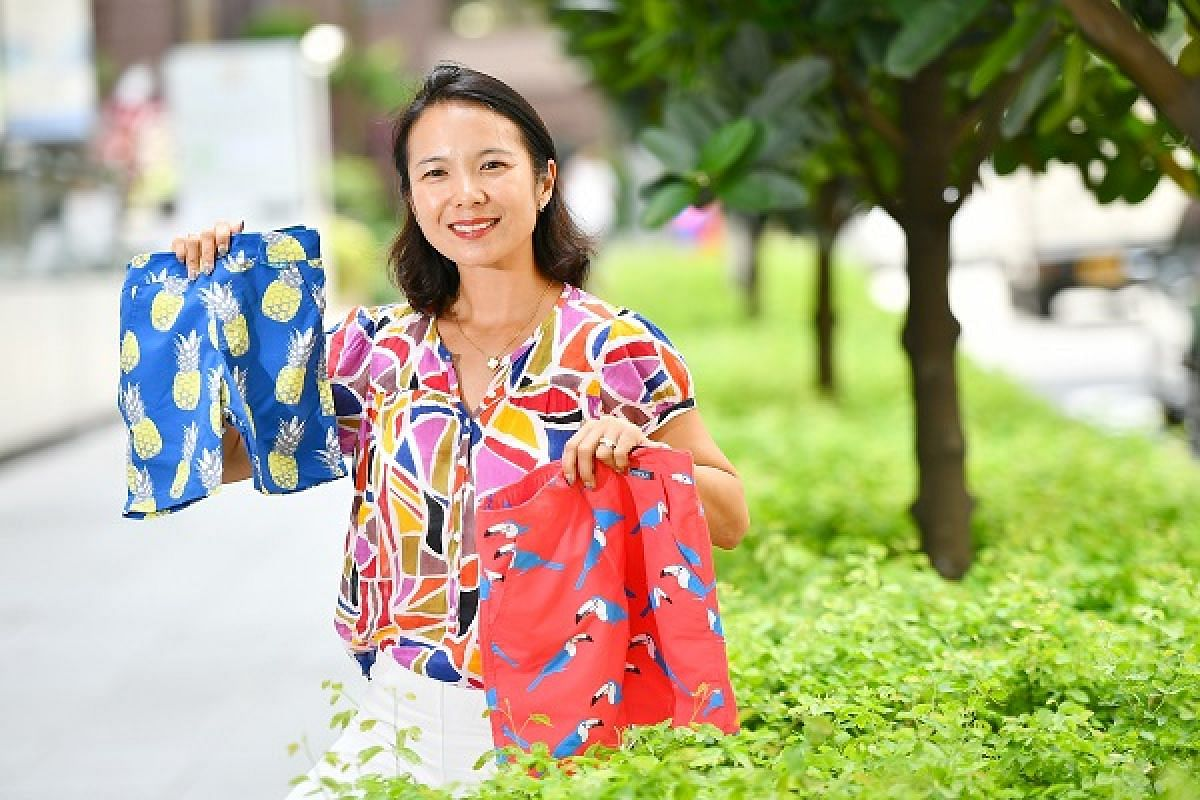 Frolik founder Ms Andrea Liu with her label's boy's swim shorts
