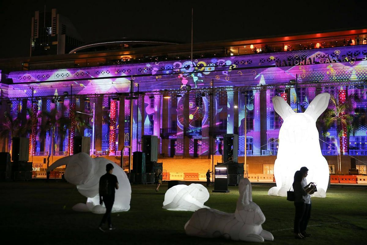 Intrude by Amanda Parer, a stunning installation of large illuminated inflatable rabbits of varying heights by Tasmanian artist Amanda Parer at the Padang.