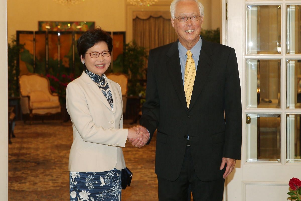 Mrs Lam and Emeritus Senior Minister Goh Chok Tong at the Istana on Aug 3.